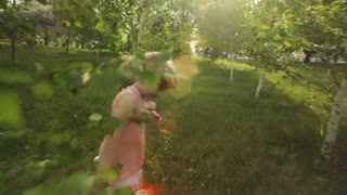 Cute girls running in garden and smiling