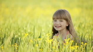 Cute kid lying in field and smiling