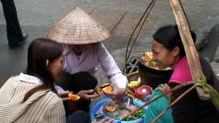Cutting Fruit In Vietnam Street
