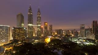 Dawn breaking over the illuminated Petronas Twin Towers, Kuala Lumpur City Centre KLCC, Malaysia, Kuala Lumpur, Asia, Time lapse