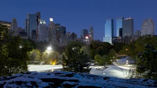Dawn Skyline of uptown Manhattan and Central Park in the snow, New York City, New York, United States of America, Time-lapse