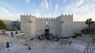 Day to night illuminated view of the Old City, Damascus Gate, Jerusalem, Israel, Middle East, Time lapse