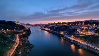 Day to Night transition view of the historic city of Porto, Portugal timelapse with the Dom Luiz bridge 4K