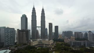Day to night view over Kuala Lumpur City Centre KLCC, Petronas Twin Towers, Malaysia, Kuala Lumpur, Asia, Time lapse