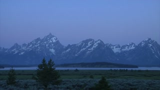 Daybreak Timelapse Over Mountain Range