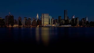 Daytime Skyline of Midtown Manhattan seen from the East River showing the Chrysler Building and the United Nations building, New York, United States of America, Time-lapse