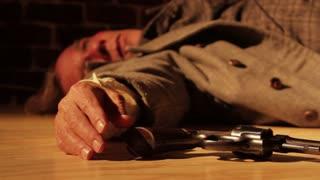 Dead Man With Pistol