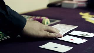 Dealer Fanning Cards in Two Hands