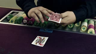 Dealer Placing Cards on the Table and Fanning the Deck