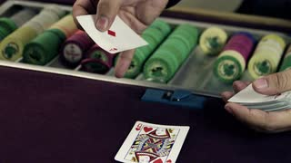 Dealer Spinning a Card Through His Fingers