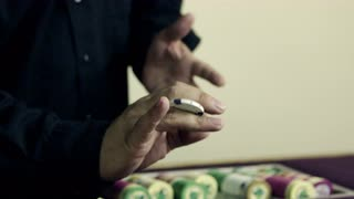 Dealer Twirling a Chip Through His Fingers