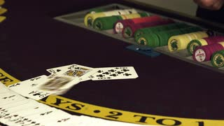 Dealing Cards Onto Gambling Table with Chips