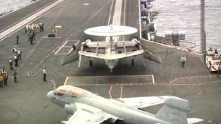Deck operations on an aircraft carrier