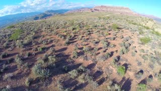 Desert landscape aerial flyover close to ground 2