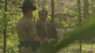 Detective And Sheriff, Medium Long Shot, Discussing In Woods At Scene Of Fire