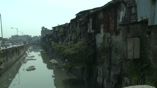 Dharavi Slum Along the Water in Mumbai