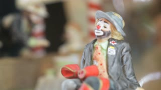 Different shots of  the clown statuettes in Akvamarine circus. Many  figurines.