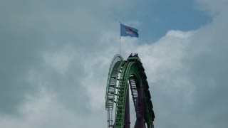 Dips on Green and Purple Roller Coaster