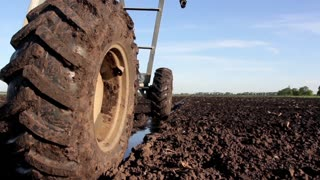 Dirty wheels of sprayer in the field