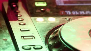 DJ mixer at night club