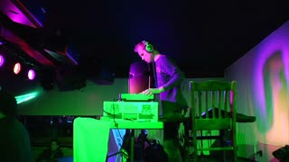 Dj Performs For Crowd With Flashing Lights