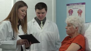 Doctors using a tablet to explain to the patient her condition
