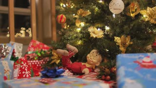 Dolly Across Presents and Christmas Tree
