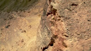 Dolly Over Cliff Face of the Mitzpe Ramon Crater