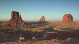 Dolly Shot Of Rocks Overlooking Monument Valley Sunset