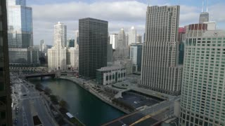 Downtown Chicago River Day Time Lapse. Time lapse shot overlooking downtown Chicago and the Chicago River during a sunny morning. Traffic on Wacker, Michigan and Columbus Streets and bridges.