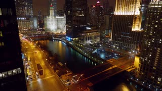 Downtown Chicago River Night Time Lapse. Time lapse shot overlooking downtown Chicago and the Chicago River at night. Traffic on Wacker, Michigan and Columbus Streets and bridges.