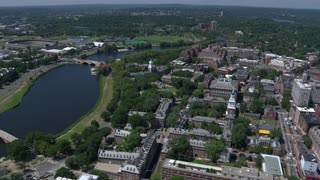 Dramatic Aerial Swing Over Harvard University From River, Boston Massachusetts