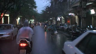 Driving Along Rainy Vietnam Street