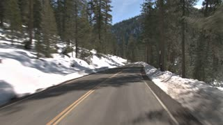 Driving Along Snowy Mountainside