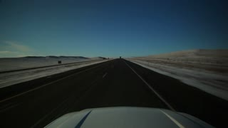 Driving Down Winter Open Road Hood Perspective 1