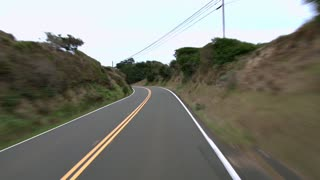 Driving On Hilly Highway By Coast
