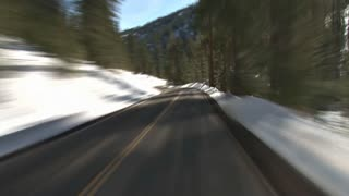 Driving Through Snowy Mountains