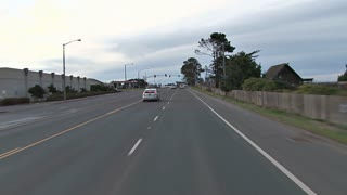 Driving Through Suburb Intersection