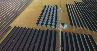 Drone shot of solar batteries in the field of solar farm of electric factory