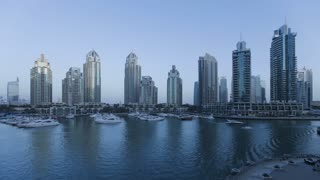 Dusk to night Time Lapse transition of Dubai Marina, a modern Development set amidst the futuristic Skyline of a modern Middle East Country, Dubai, Arabian Peninsula, UAE