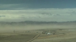 Dusty Winds Blowing Past Farm Town