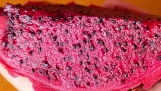 Eating Pitahaya/Dragon Fruit with a Spoon. Close up. Macro.