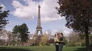 Eiffel Tower with Young Couple Embracing