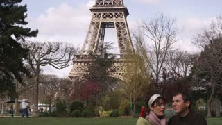 Eiffel Tower with Young Couple in Love