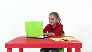 Eight Year Old Girl Laughing at Computer