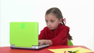 Eight Year Old Girl Working at the Computer 3