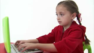 Eight Year Old Girl Working at the Computer 4