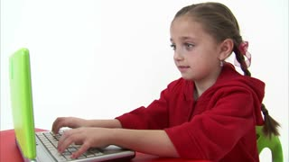 Eight Year Old Girl Working at the Computer 5