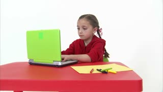 Eight Year Old Girl Working at the Computer 7