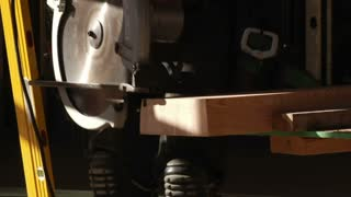 Electric Saw Cuts Wood